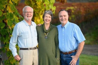 Earl, Hilda, and Greg Jones with vineyard in background.